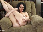 Lustful attractive lady feels her perky breasts before pleasuring her twat.