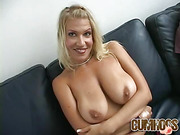 Big breasted horny blonde babe plays with her hard nipples.
