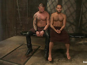 Swarthy gay gets gagged and bound with chains before hardcore anal fuck in bdsm dungeon