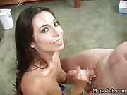 Stunning brunette displays her banging body as she gets on her knees wearing her blue tube shirt and jeans shorts while she jacks off ha huge dick before she gets naked and makes it blasts on her soft tits.