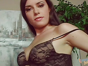 Steaming hot brunette teases with her indulging body wearing black underwear and brown robe before she gets naked and rubs her pussy before she jacks a huge dick on a red couch then gets on her knees and makes it cum on her mouth.