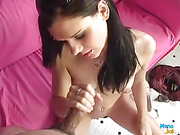 Naked hottie with juicy tits and banging body sits on a pink couch and rubs her indulging pussy while she strokes a huge dick.