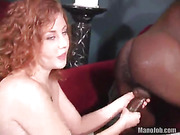 Curly redhead teases with her indulging body before she strips off her pink bra and bared her big breasts then gets on her knees and wanks a big black dick then makes it blow in her mouth.