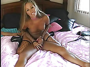 Stunning blonde pose her smoking in black and pink lingerie before she gets naked and shows her alluring boobs while she rides on her man's dick til it blows on her pussy as she rides on a pink bed wearing her fishnet gloves and stockings.