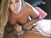 Steaming hot chick pose naked and teases with her indulging boobs and juicy pussy as she displays her stunning body wearing her black fishnet gloves and stockings on a pink bed before she jacks a dick hard then rides on it.