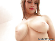 Slut looks straight to the cam, while playing with her big natural tits