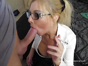Blonde office girl gets to suck her officemate's hung dicks.