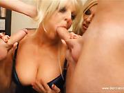Two blonde girls take turns in sucking two very hung dicks.