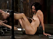 Hot slave gets cuffed naked on metal bars and gets her juicy tits clipped and her mouth gagged with a black ball then lets her brutal master rub her twat with a white vibrator before she gets cuffed again and bent over on different pipes then lets him han