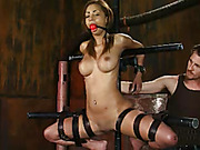 Alluring babe gets strapped naked in different metal bars then gets her mouth gagged with a red ball, her juicy tits clipped with laundry pins, blindfolded then gets her lusty pussy rubbed with different vibrators in different positions.