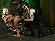 Foxy blonde gets bounded on a metal chair then gets her mouth gagged with a red ball while she gets her pussy sucked with a black vacuum before she gets wrapped in plastic wrapper then gets her hot boobs dripped with melted wax while her redhead master sh