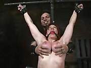 Luscious redhead with bounded in different metal pipes then gets tortured in different positions as she gets her mouth strapped with a red ball gag, her banging body and big round boobs clipped with laundry pins and her sweet pussy rubbed with a white vib