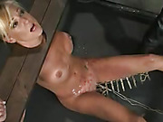 Blonde chick gets tied and cuffed on different bars then gets her mouth gagged with a red ball her hot body dripped with melted wax before she gets her sweet tits sucked by suction cups while she gets her lusty pussy vibrated.