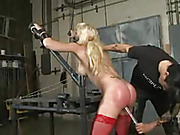 Blonde hottie gets tied naked on different bars and beds then gets her sweet pussy drilled with a glass toy then her hot boobs sucked with suction cups before she gets hanged upside down and gets her smoking hot body whipped with her mouth gagged with a r