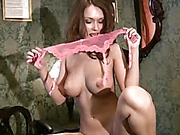 Red haired babe with huge natural tits and nice ass is touching herself and posing