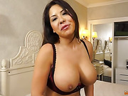 Horny mature rides a big hard dick of a hunky guy in the bed