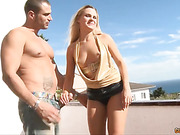 Busty blonde woman has some cock handjob and fucking while they're outdoor