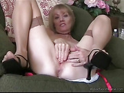 Luscious milf sits naked and spreads her legs wide then rubs and fingers her sweet pussy wearing her skin toned stockings and black high heels on a green couch before she lets a horny dude jacks his cock til he blasts his spunk in a glass then drinks it.