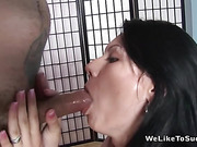 Brunette poses in red lingerie, then gets mouth-fucked and receives a facial