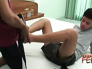 skinny japanese fella gives