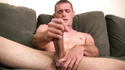 skinny bloke sitting naked