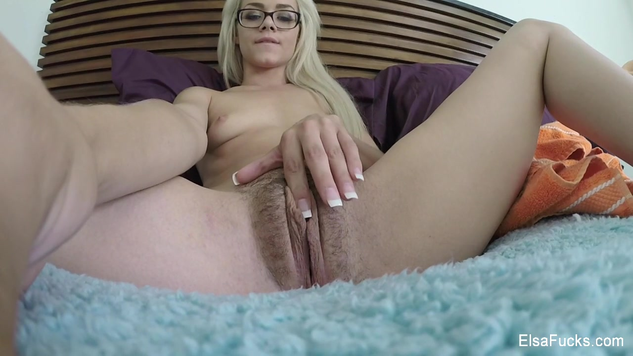 Blonde Hottie Teases With Her Small Tits And Skinny Body As She Pose Naked On A Blue Bed Before She Fingers Her Pussy In Different Positions.