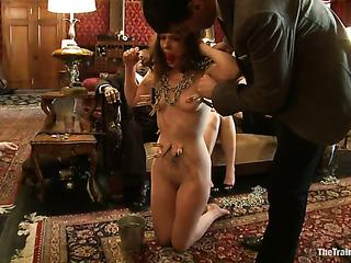 long-ahired brunette slave gets