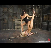 Sadistic dark haired whore dominates over a blonde slave