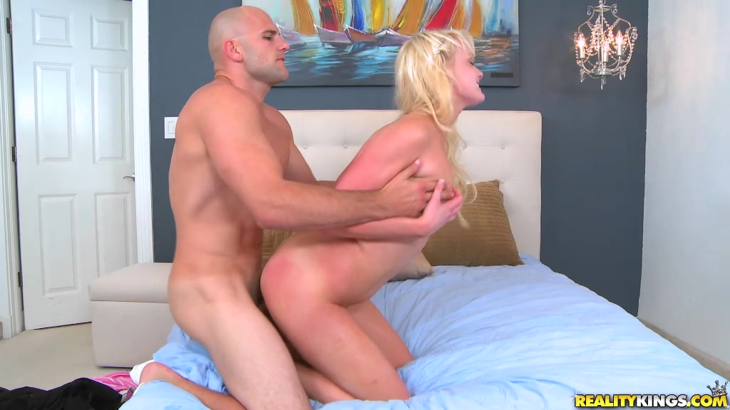 Blonde In Pink Miniskirt And Black Top Taking Off Her Undies And Tasting Cum After Deep Pussy Fucking On The Blue Bed