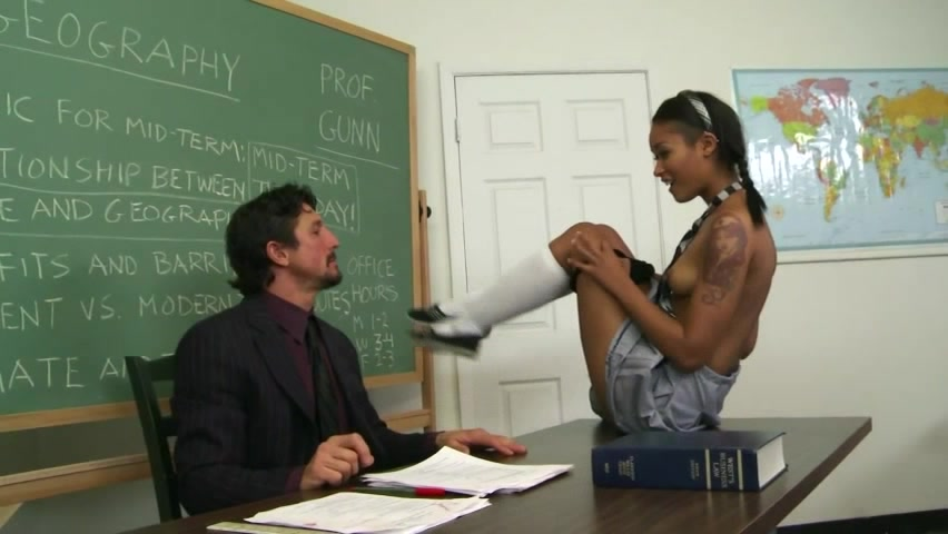 Pleasing Brunette In Grey Skirt And Striped Tie Gets Her Pussy Licked In A Classroom