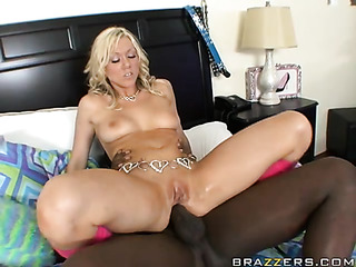 intense tattooed blonde with