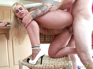 tattooed blonde milf wearing