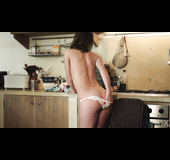 Adorable young sex doll goes nude in the kitchen
