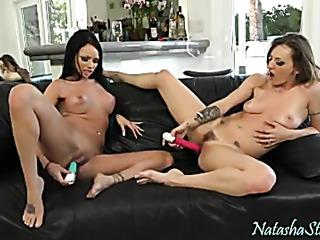 two naked ladies caress