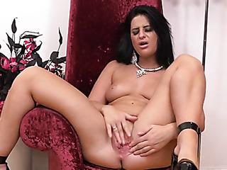 sexy mature latina sits