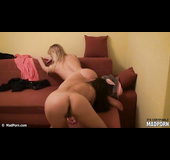 Brunette eats a blonde's pussy in doggy style pose