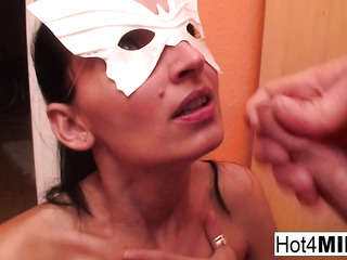 mask-wearing tanned brunette sucking