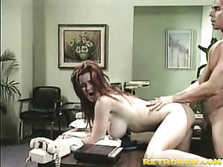 horny redhead secretary bends