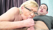 glasses-wearing mature lady gets