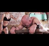 Blonde tattooed mistress punishes bald fat slave