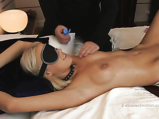 Blond man is tied up while blindfolded