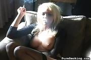 smiling blonde smokes window