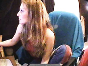 long-haired brunette red vest