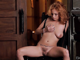 inked redhead with big