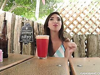 long-haired brunette drinking semen