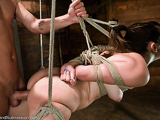bound and suspended brunette