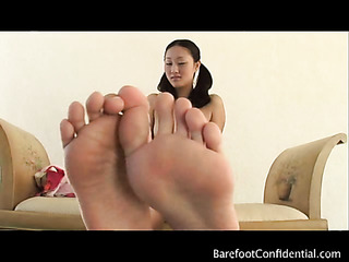 pigtailed asian girl gives