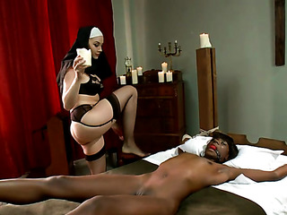 strap-on wearing nun with