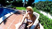 blonde gives poolside blowjob