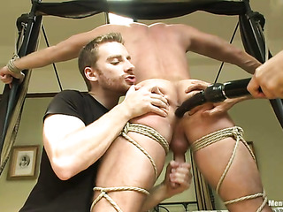 muscled dude blindfold ropes